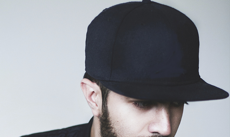 Man wearing black blank baseball cap
